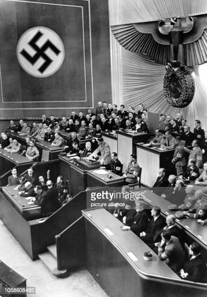 The image from the Nazi Propaganda shows Reich Chancellor Adolf Hitler delivering a speech to the Reichstags in the Kroll Opera House in Berlin...