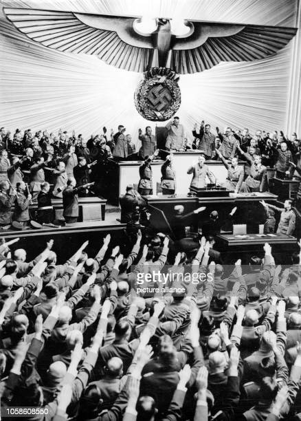 The image from the Nazi Propaganda shows Reich Chancellor Adolf Hitler greeting the MPs of the Reichstag in the Kroll Opera House in Berlin Germany...