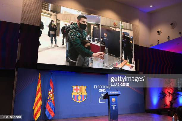 The image of Barcelona's Argentinian forward Lionel Messi voting for FC Barcelona presidential election is displayed at the Camp Nou stadium in...