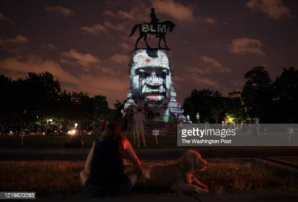 IT The image of George Floyd along with the Black Lives Matter letters are projected on to the Robert E Lee Statue on Monument Avenue in Richmond VA...