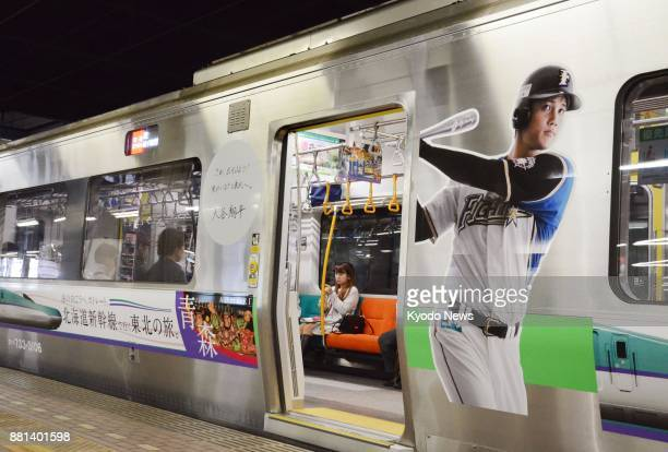 The image of Japanese baseball sensation Shohei Otani of the Nippon Ham Fighters is emblazoned on the sides of trains as seen on this one at JR...