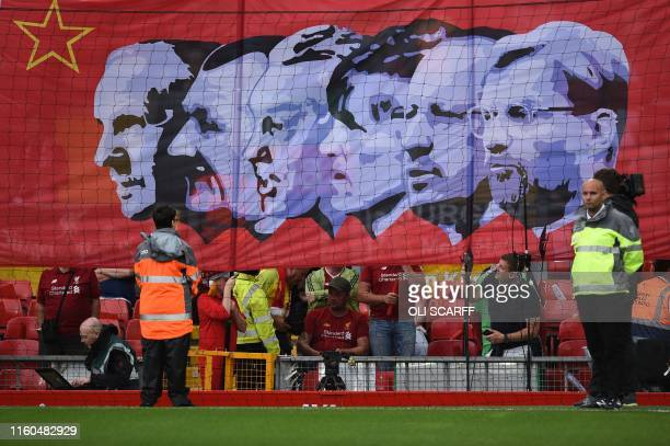 The image of Liverpool's German manager Jurgen Klopp is added to a banner of Liverpool's managers as it is hoisted before the English Premier League...