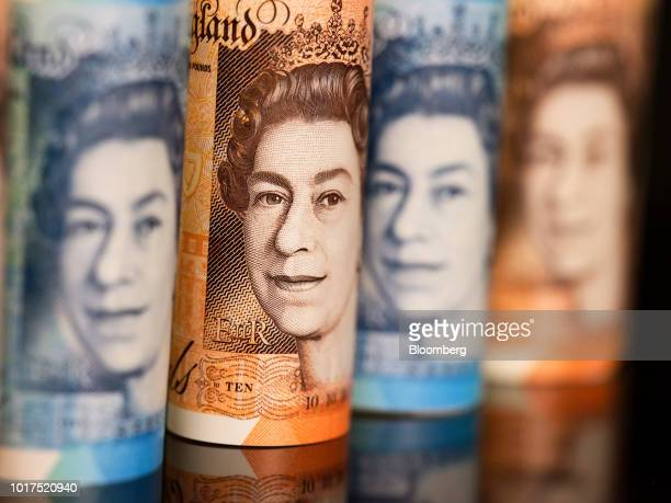 The image of Queen Elizabeth II sits on British 10 and five pound banknotes in this arranged photograph in London UK on Wednesday Aug 15 2018 The...