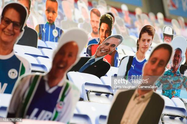 The image of the 44th President of the United States, Barack Obama, amongst cardboard cut out during the pre-match warm-up fans during the Sky Bet...