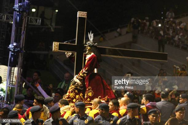 The Image of the Black Nazarene which is said to be miraculous is carried by its Peana into its Andas by the hijos del Nazareno for the commencement...