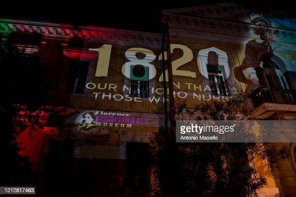 The image of the founder of modern nursing Florence Nightingale is projected on the facade of the hospital during a happening to say thank yoy nurses...