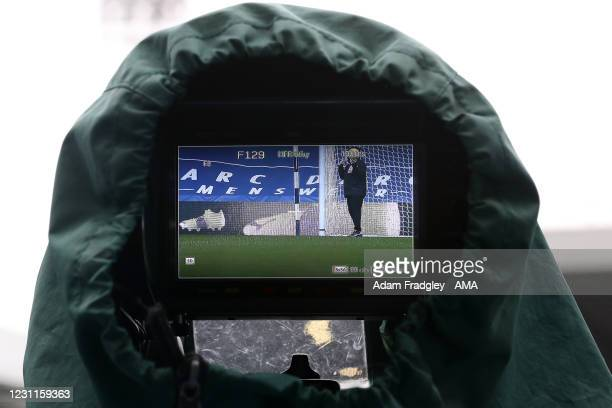 The image on the viewfinder of a Sky TV / Television Camera with wet weather covers at the side of the pitch shows the Hawk-Eye goal line technology...