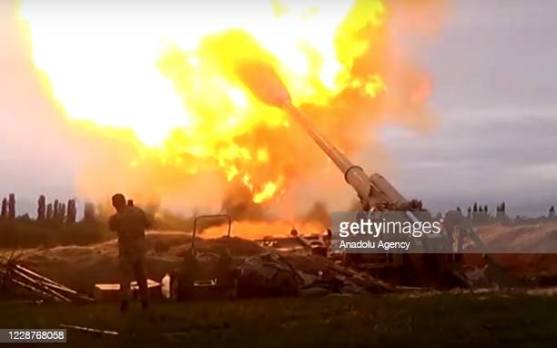The image shared by Azerbaijan Defence Ministry shows a howitzer firing munitions towards Armenian positions after the launch of a counter then a...