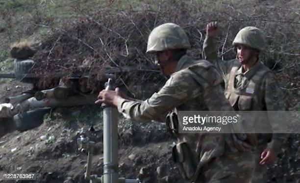The image shared by Azerbaijan Defence Ministry shows the Azerbaijan troops hit the Armenian positions on September 28, 2020. Azerbaijani forces take...
