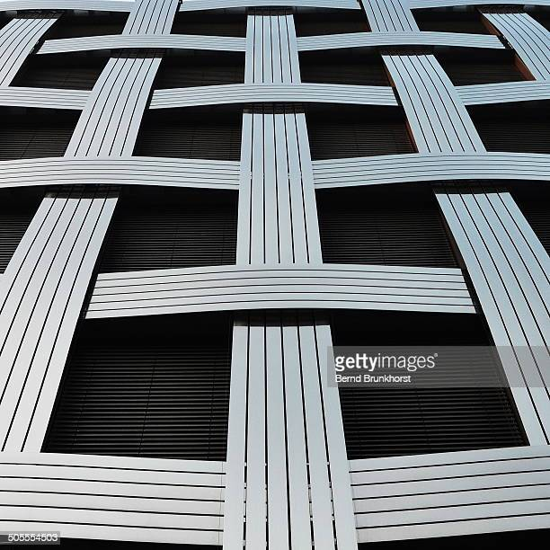 CONTENT] The image shows a facade in Hamburg Hammerbrook The facade looks like a woven fabric with silver and black elements It looks very abstract