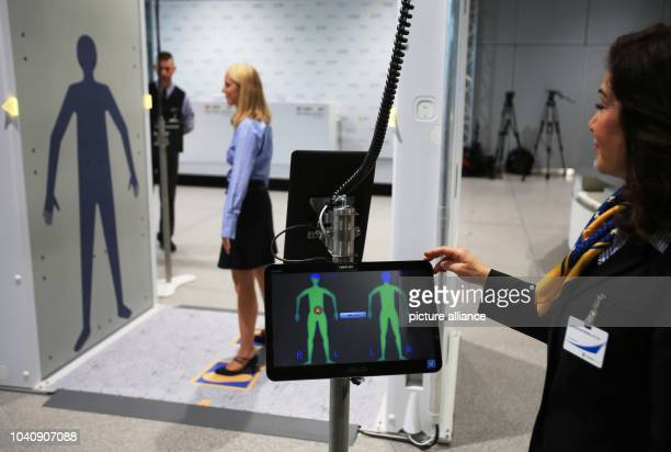 The images of a fullbody scanner can be seen on a monitor in Cologne Germany 15 November 2016 Authorities and air travel companies have jointly...