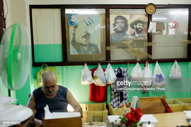 The images of Cubas President Raul Castro Che Guevara and Camilo Cienfuegos are on display at an office at the H Upmann tobacco factory during the...