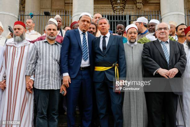 The imam of Drancy Hassen Chalghoumi Brussels' alderman Alain Courtois Egyptian sheikh Ahmed Mohamed elTayeb and MR's Richard Miller pose during the...