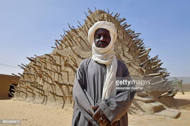 The Imam of the Askia Mosque Issa Moussa Songare stands in front of grave of Askia which was built in the 15th century in honor of King Mohammed I...