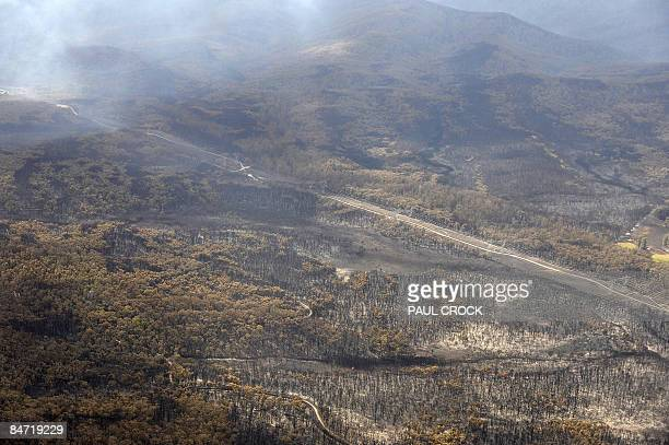 The immediate aftermath of a wildfire which threatened one of the main electricity transmission lines to Melbourne destroying farms and the Bunyip...
