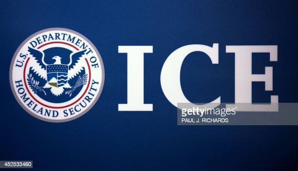 The Immigration and Customs Enforcement seal is seen before a press conference discussing ongoing enforcement efforts to combat human smuggling along...