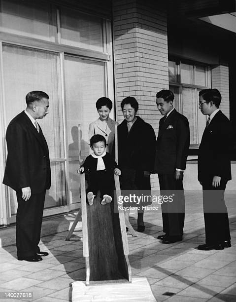 The imperial family of Japan poses for the New Year photograph at their new palace in Tokyo, Japan, on December 27, 1961 - From left to right:...