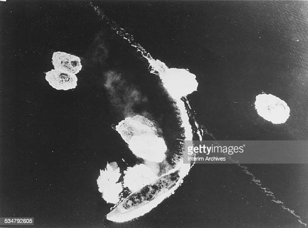 The Imperial Japanese Navy battleship Yamato wheels in a tight curve to avoid bombs from American attack planes in Kure Bay Japan March 1945