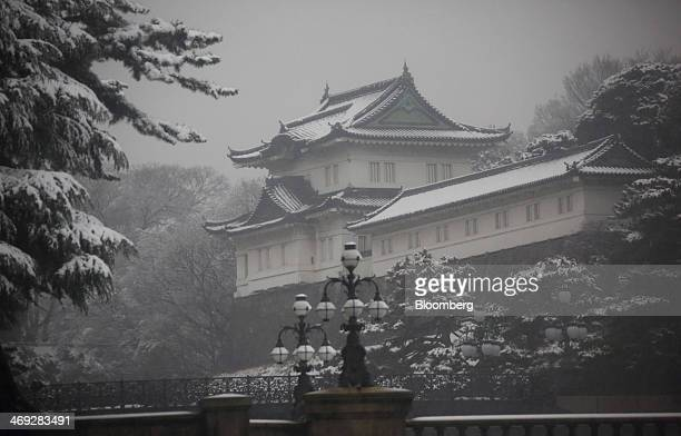 The Imperial Palace stands as snow falls in Tokyo Japan on Friday Feb 14 2014 Snowfall in Tokyo disrupted train and plane services for the second...