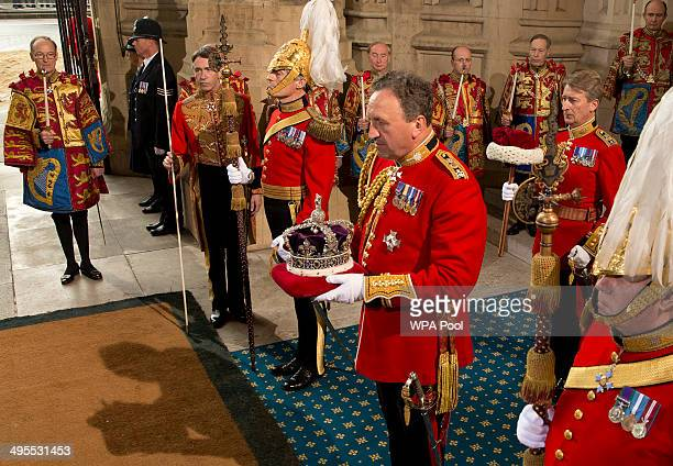 The Imperial Sate Crown is held by a member of the Queen's Bodyguard as he waits for his carriage to leave the Palace of Westminster following the...
