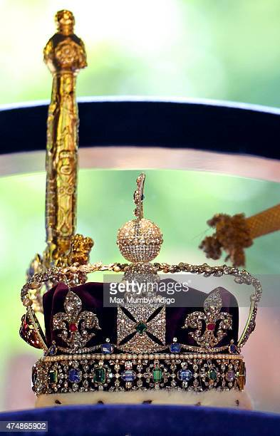 The Imperial State Crown and Sword of State being driven down The Mall in a horse drawn carriage after the State Opening of Parliament on May 27 2015...