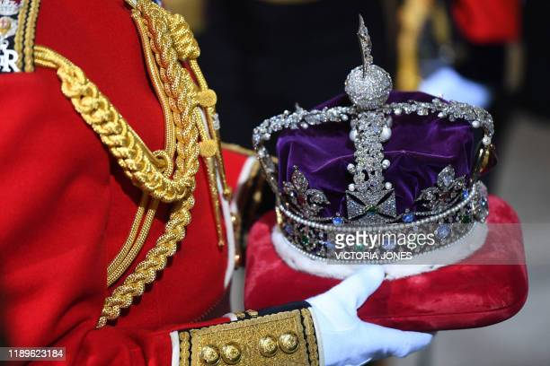 The Imperial State Crown is brought to the Sovereign's Entrance of the House of Lords for the State Opening of Parliament at the Houses of Parliament...
