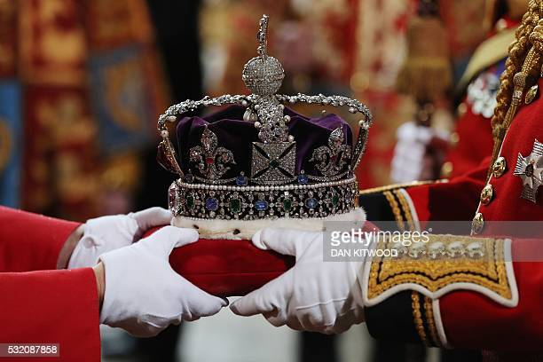 The Imperial State Crown is carried from the Houses of Parliament during the State Opening of Parliament in central London on May 18 2016 The State...