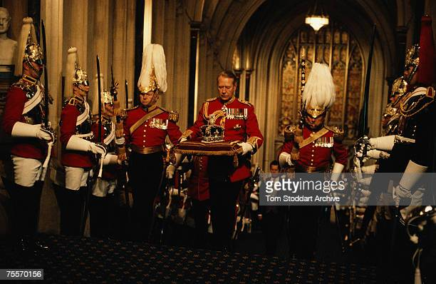 The Imperial State Crown is carried in during the State Opening of Parliament circa 1990 The crown is flanked by two members of Her Majesty's Body...