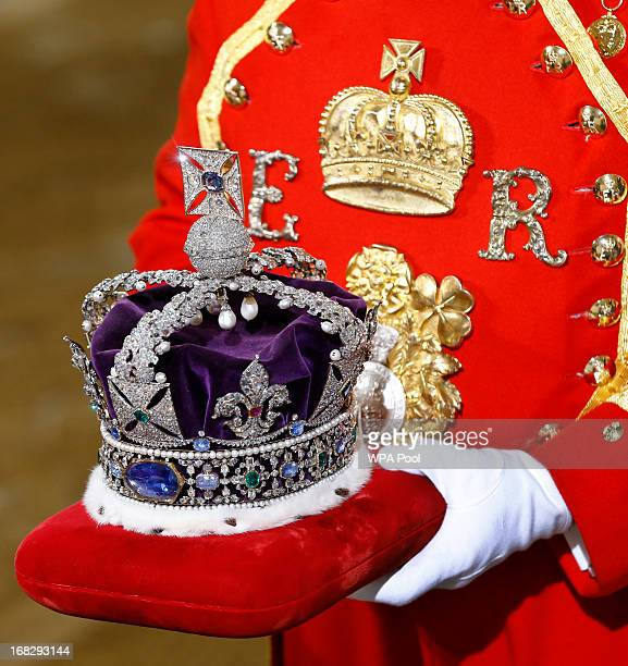 The Imperial State Crown is carried on a cushion as it arrives for the State Opening of Parliament at the Houses of Parliament on May 8 2013 in...