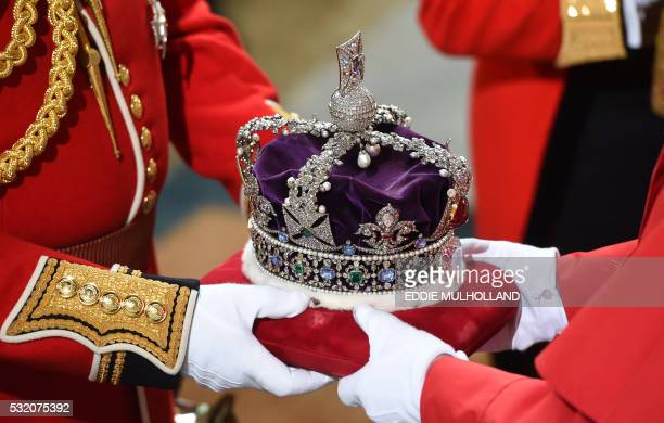 The Imperial State Crown is carried on a cushion during the State Opening of Parliament at the Palace of Westminster in central London on May 18 2016...
