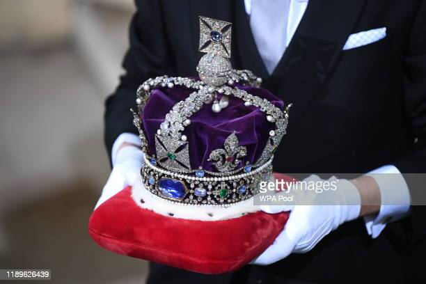 The Imperial State Crown is carried through the Sovereign's entrance ahead of the state opening of parliament at the Houses of Parliament on December...