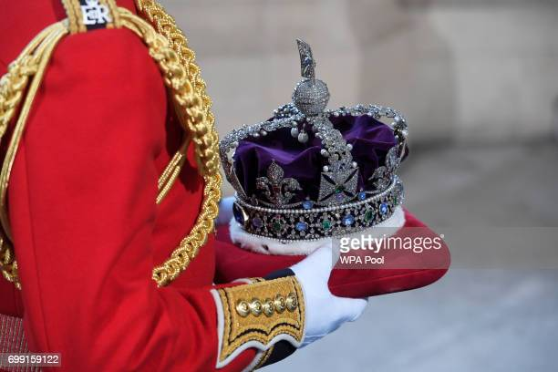 The Imperial State Crown is carried to the ceremony during the State Opening of Parliament in the House of Lords at the Palace of Westminster on June...