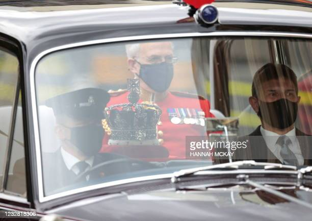 The Imperial State Crown is driven from Buckingham Palace for the State Opening of Parliament at the Houses of Parliament in London on May 11 which...