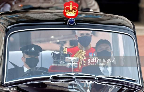 The Imperial State Crown is driven from Buckingham Palace to the Houses of Parliament for the State Opening of Parliament in London on May 11 which...