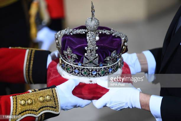 The Imperial State Crown is passed over in the Sovereign's entrance ahead of the state opening of parliament at the Houses of Parliament on December...