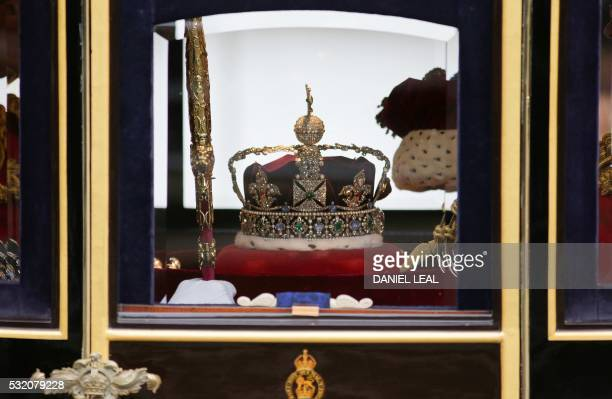 The Imperial State Crown is pictured as it travels towards the Houses of Parliament in central London on May 18 during the State Opening of...