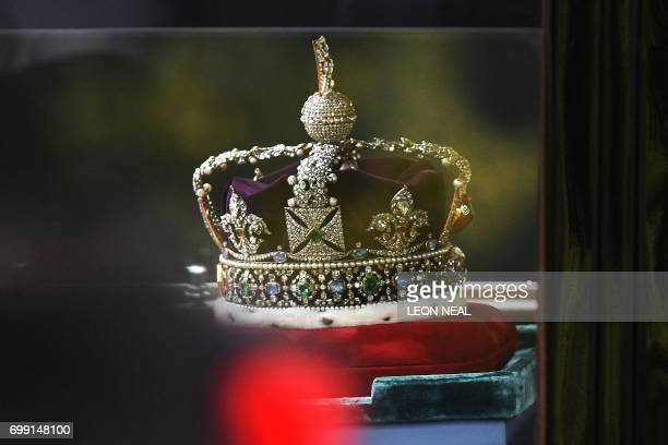 The Imperial State Crown travels by car to the Houses of Parliament ahead of the State Opening of Parliament in London on June 21 2017 Queen...