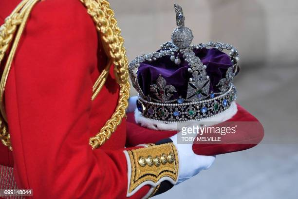 The Imperial State Crown travels is carried into the Houses of Parliament ahead of the State Opening of Parliament in London on June 21 2017 Queen...