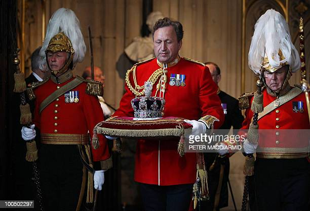 The Imperial State Crown worn by Britain's Queen Elizabeth II is taken from Parliament during the State Opening of Parliament at the Houses of...