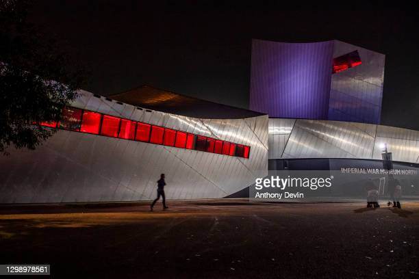The Imperial War Museum in Salford is seen illuminated to mark Holocaust Memorial Day on January 27, 2021 in Manchester, England. Holocaust Memorial...