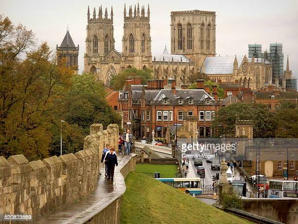 The imposing Gothic building of the York minster seen from the Roman times city wall.