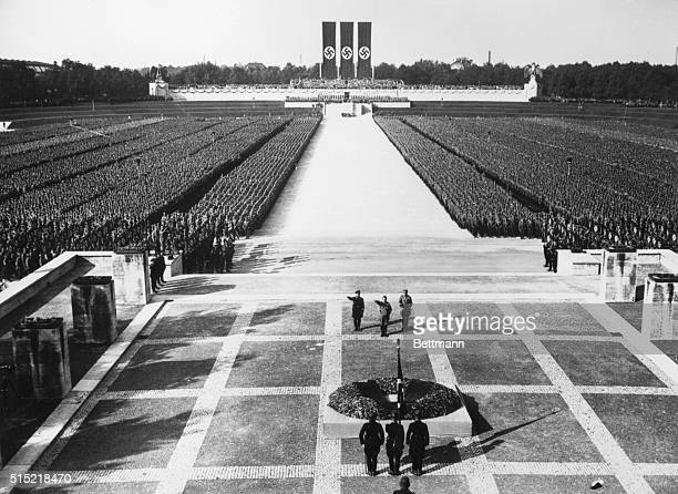 The imposing scene during the last hours of the Nazi Congress at Nuremberg as LeaderChancellor Adolf Hitler saluted the Nazi dead as thousands of the...