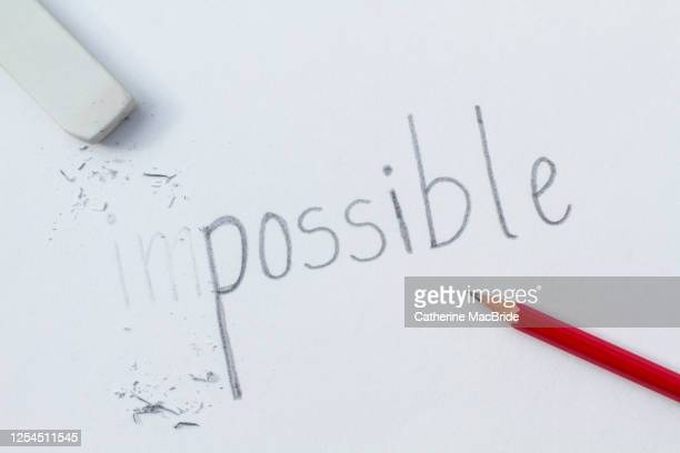 the impossible becomes possible - western script stock pictures, royalty-free photos & images