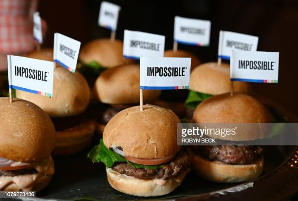 The Impossible Burger 20 the new and improved version of the company's plantbased vegan burger that tastes like real beef is introduced at a press...
