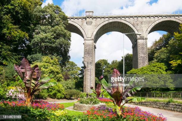 The impressive Grade II listed Trenance Railway Viaduct overlooking the sub tropical Trenance Gardens in Newquay in Cornwall.