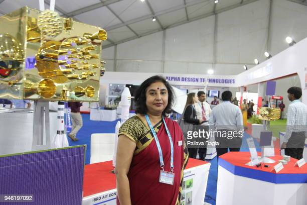 The incharge for the satellite project at Alpha Design Sujatha Deepak stands near a replica of the navigation satellite at DEFEXPO 2018 a defence...