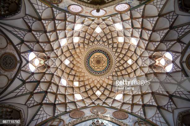 the incredibly decorated ceiling of a mosque in kashan, iran - david ewing stock pictures, royalty-free photos & images