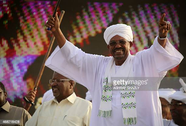 The incumbent president and candidate of the ruling National Congress Party for Sudans presidency Omar alBashir waves on March 31 2015 in the capital...