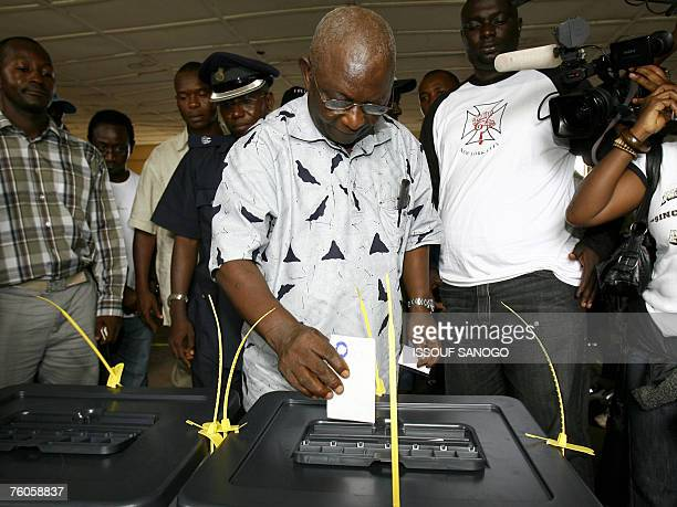 The incumbent vice president and ruling Sierra Leone People's Party presidential candidate Solomon Berewa casts his vote at a polling station in...