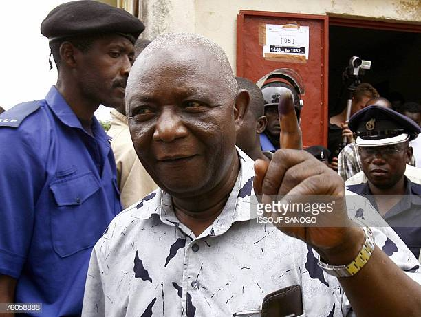 The incumbent vice president and ruling Sierra Leone People's Party presidential candidate Solomon Berewa leaves a polling station after casting his...